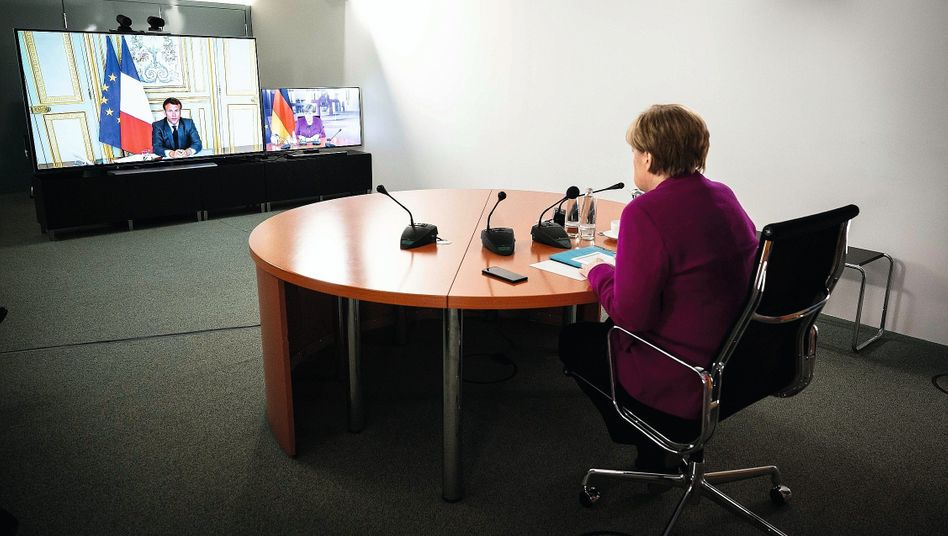 French President Emmanuel Macron and German Chancellor Angela Merkel in a video conference on Monday