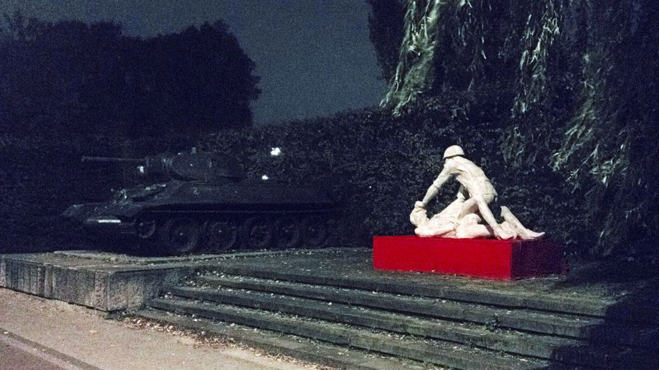 The controversial sculpture alongside the Soviet tank in Gdansk, Poland.