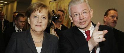 Kanzlerin Merkel, Ministerpräsident Koch: Rammbock auf Kurs