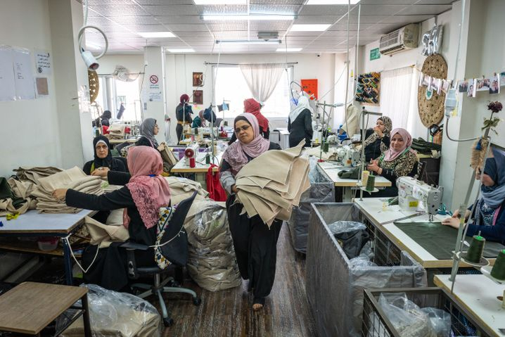 A sewing shop in Amman where Jordanian and Syrian women work side by side.