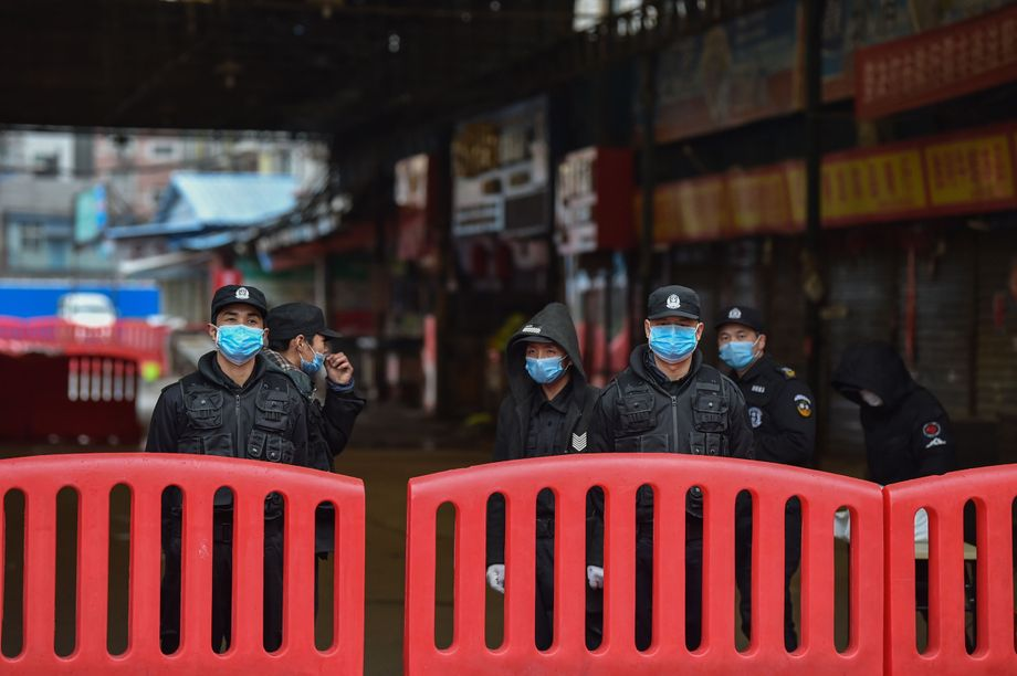 Security personnel guard the Huanan seafood market where the coronavirus was detected in Wuhan on Jan. 24.