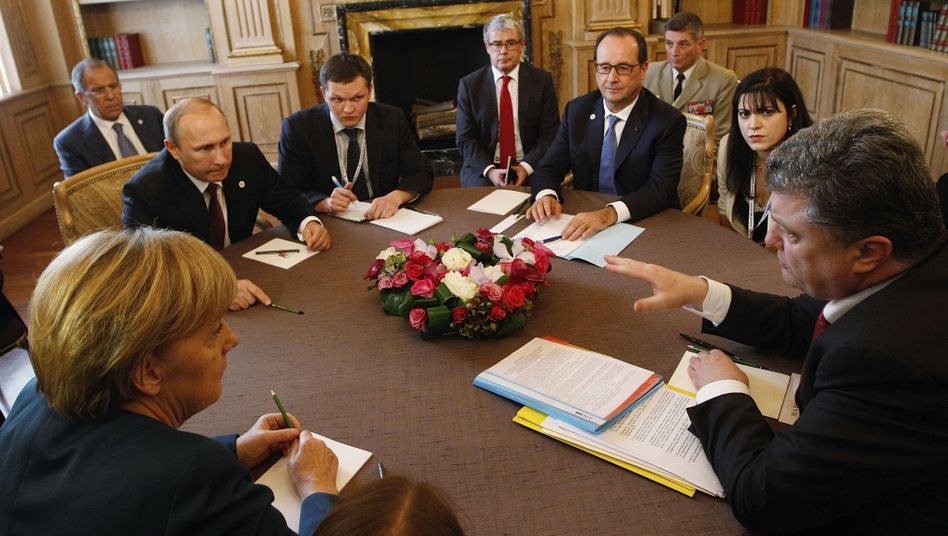 Merkel, Putin, Hollande und Poroschenko im Oktober in Mailand