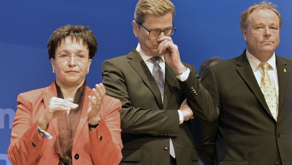 Top FDP leaders react to Sunday's election result: Board member Birgit Homburger, Foreign Minister Guido Westerwelle and Development Minister Dirk Niebel.