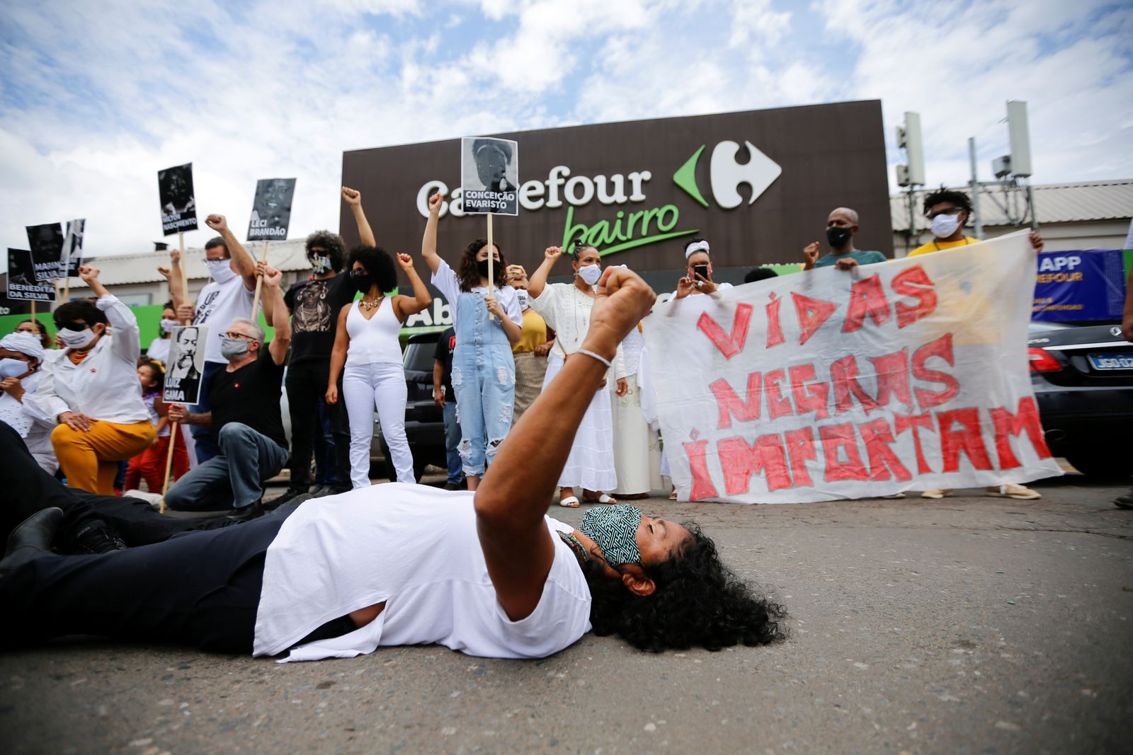 Demonstrators take a part in a protest in front of a Carrefour supermarket, after Joao Alberto Silveira Freitas was beaten to death by security guards at a Carrefour supermarket
