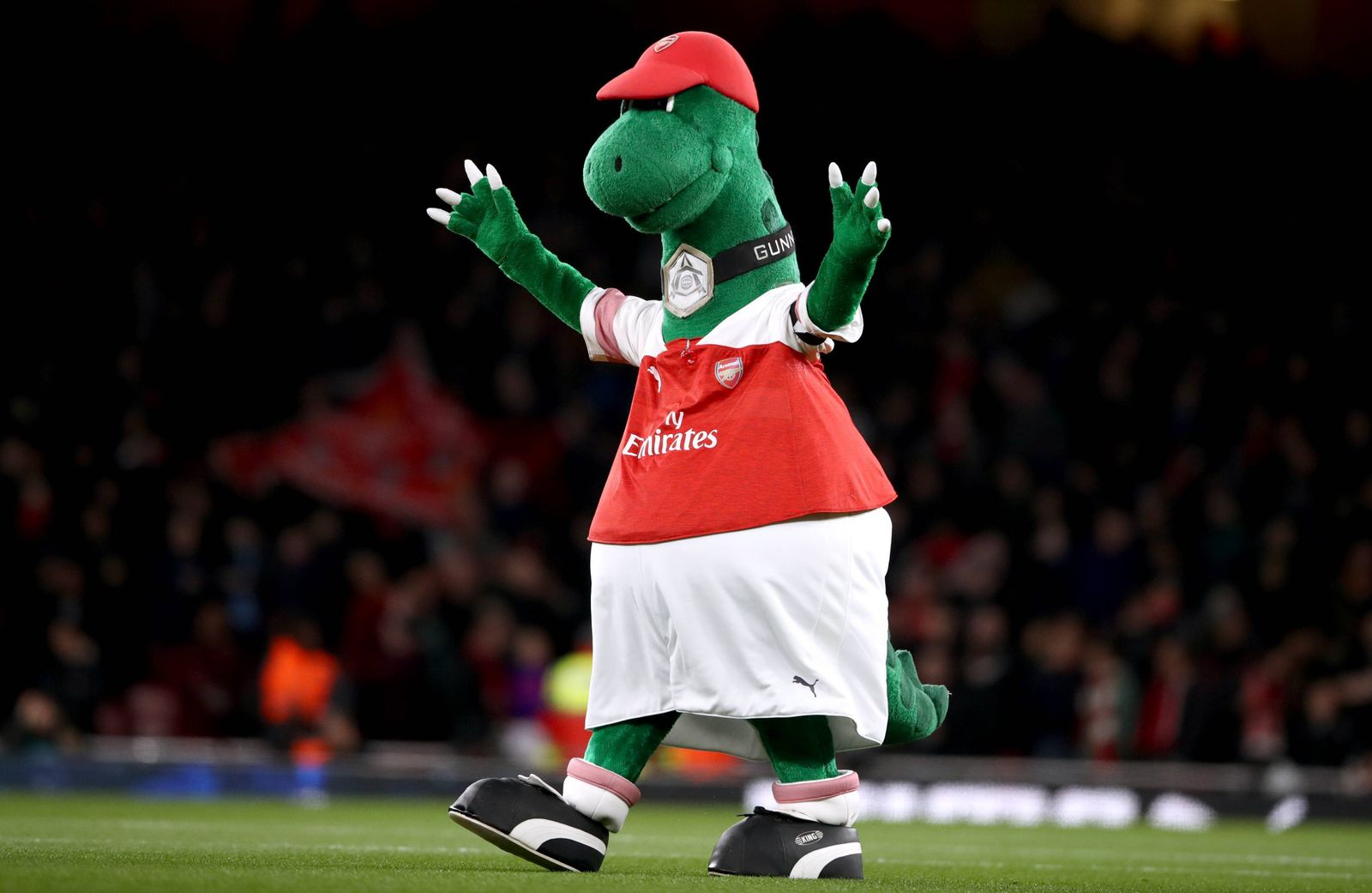 Arsenal v Liverpool - Premier League - Emirates Stadium Arsenal mascot Gunnersaurus waves to fans prior to the match ki