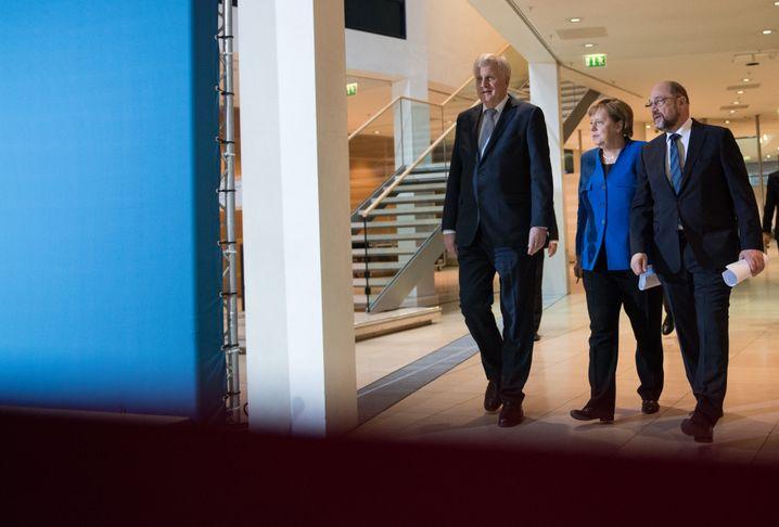 CSU party boss Horst Seehofer, Chancellor Angela Merkel and SPD head Martin Schulz after talks on Jan. 12.