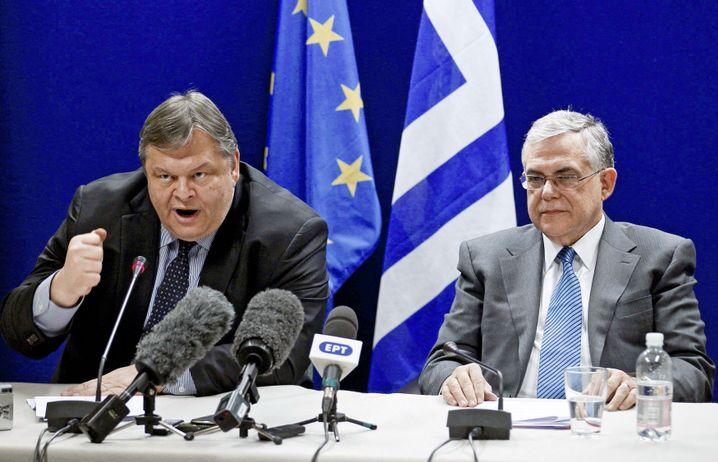 Friedrichs Anreize lösen beim griechischen Finanzminister (l.) Freude, beim Premier (r.) Glück und bei beiden Begeisterung aus