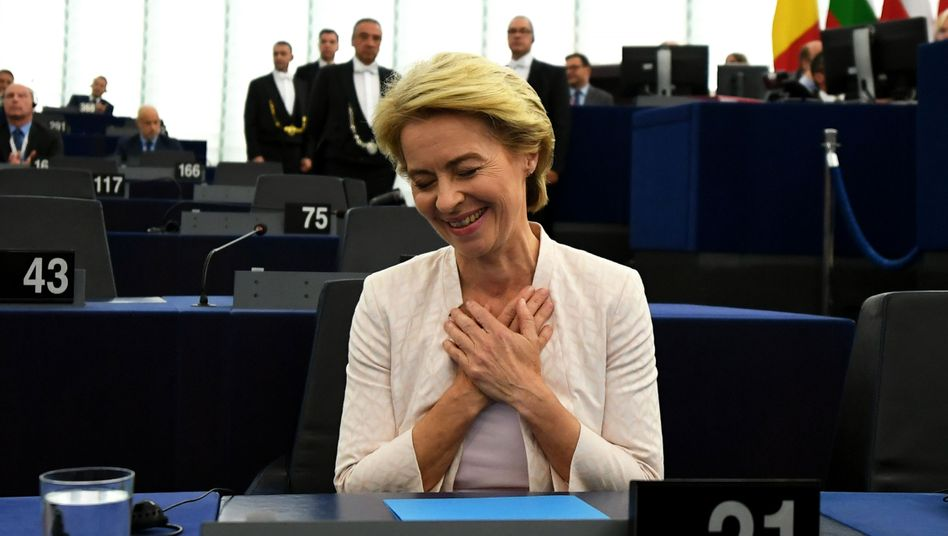 Ursula von der Leyen reacts after a vote at the European Parliament in Strasbourg, where she was elected the new president of European Commission.