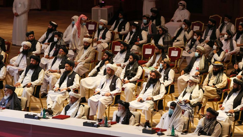Sie verhandeln über die Zukunft von Afghanistan: Vertreter der Taliban und der Regierung bei ihrem Treffen in Katar
