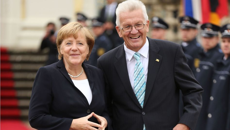 Chancellor Angela Merkel and Winfried Kretschmann, the Green governor of the state of Baden-Württemberg, during a ceremony last year.