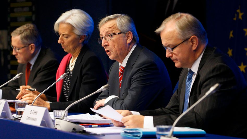 The Euro Group press conference on Tuesday morning. From left: Klaus Regling, CEO of the European Financial Stability Facility (EFSF), IMF head Christine Lagarde, Euro Group chairman Jean-Claude Juncker and European Monetary Affairs Commissioner Olli Rehn.