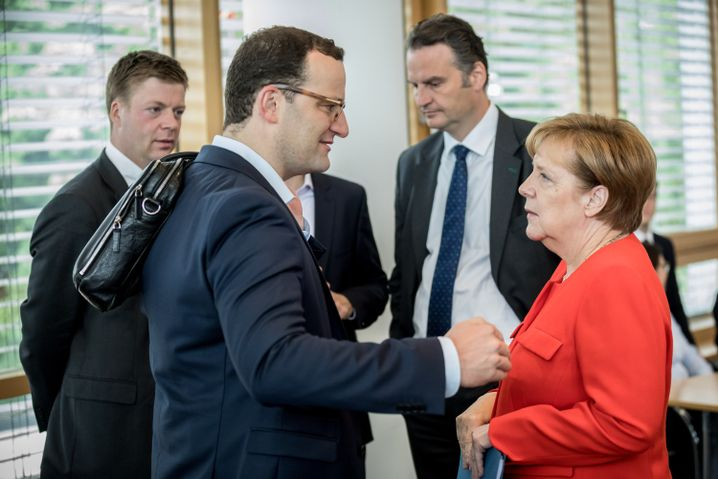 CDU-Kontrahenten Spahn und Merkel