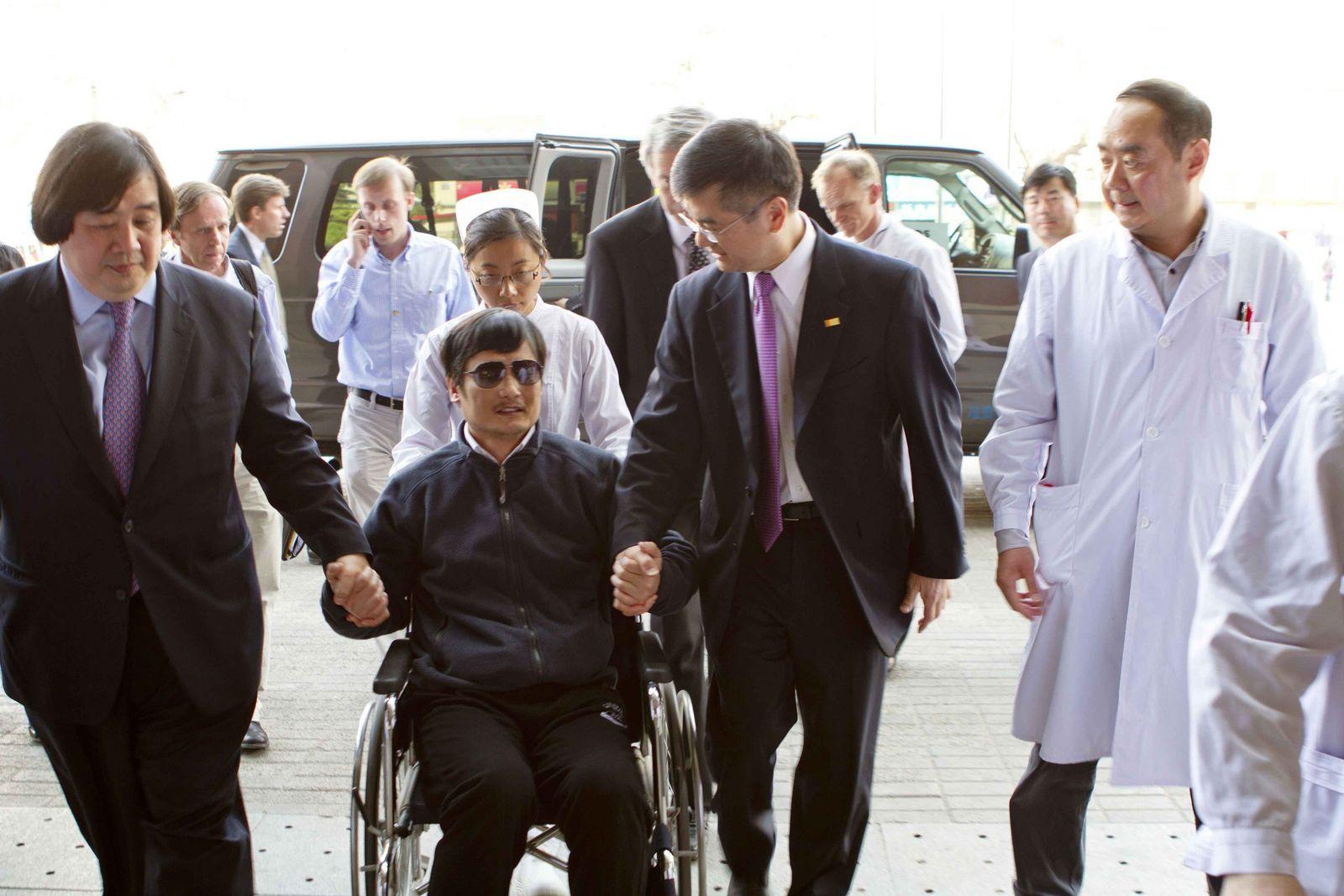 Chen China im Rollstuhl