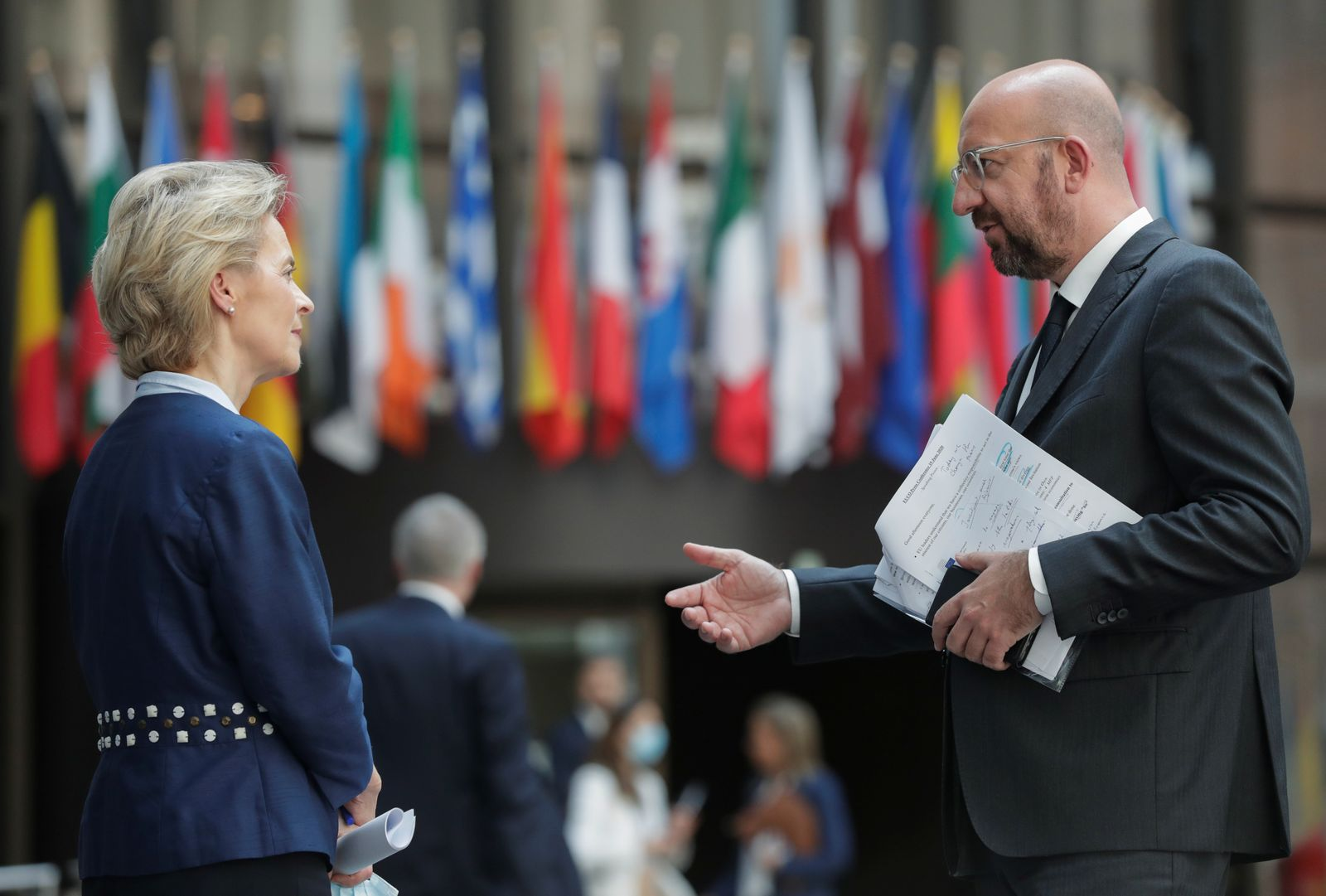 European Commission President Ursula Von Der Leyen and European Council President Charles Michel chat at the end of a news conference following European summit in video conference format, in Brussels