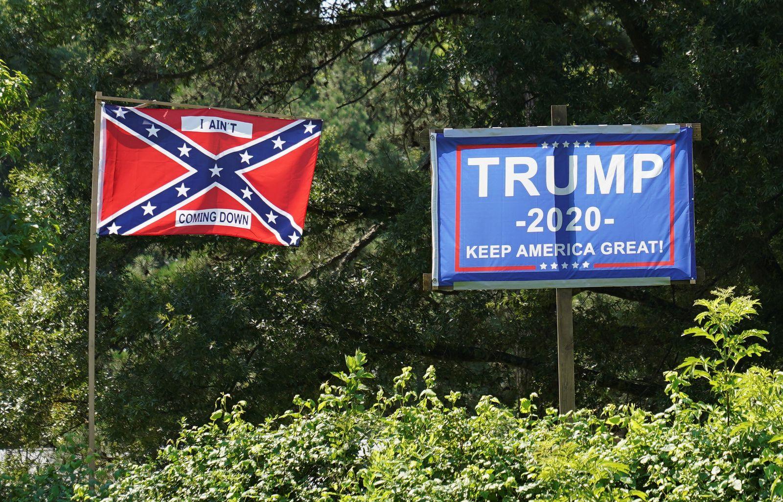 A Trump beside a Confederate flag in Virginia