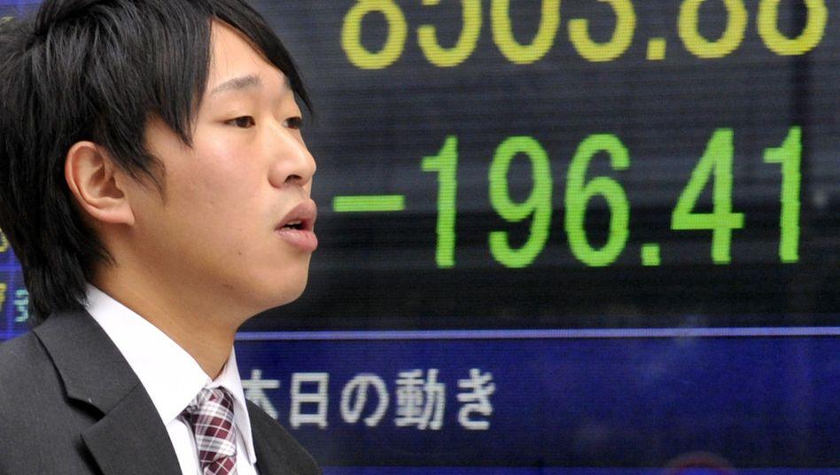 Börsenhändler in Tokio: Neue Hiobsbotschaften aus Athen