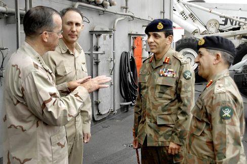 Gen. Pasha (r) with Pakistani Chief of Staff Gen. Ashfaq Kayani aboard the USS Abraham Lincoln in August.