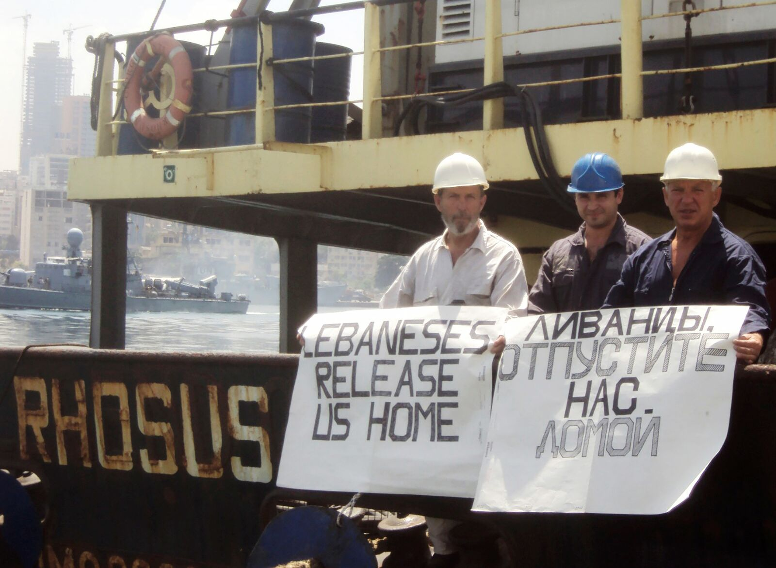 Captain Boris Prokoshev and crew members demand their release from the arrested cargo vessel Rhosus in the port of Beirut