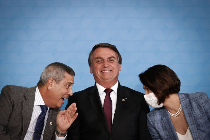 "President Bolsonaro flanked by his wife Michelle and General Walter Souza Braga Netto: ""A president does not have to know everything. But he should have the humility to consult people who know better than he does."""