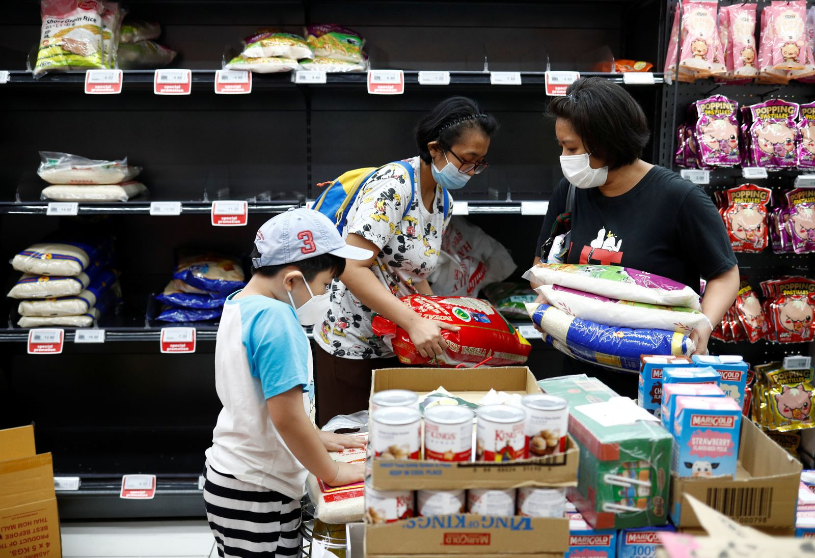 People stock up on rice after Singapore raised the coronavirus outbreak alert level to orange, at a supermarket in Singapore