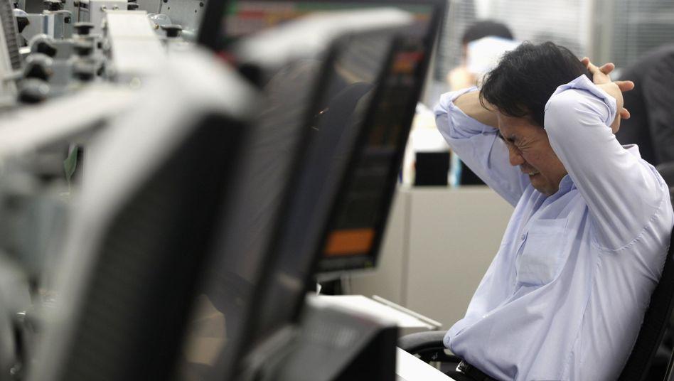 Händler an der Tokioter Börse: Große Bedenken gegen den Euro