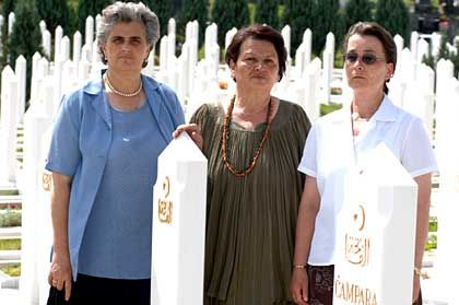 Widows Zumra Sehomerovic, Kada Hotic and Sabaheta Fejzic (from left to right) in Bare cemetery, Sarajevo.