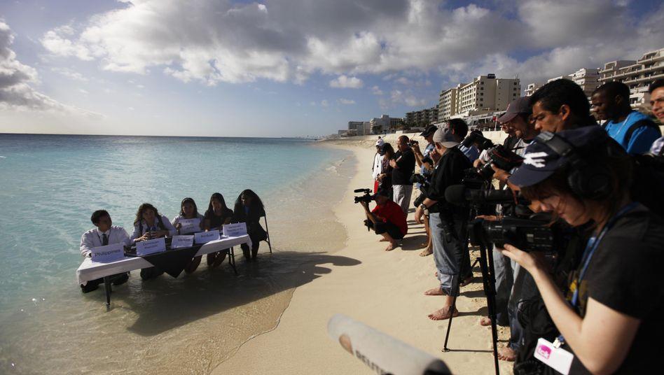 Aktivisten, Journalisten am Strand von Cancún: Einigung nach dramatischen Schlussstunden