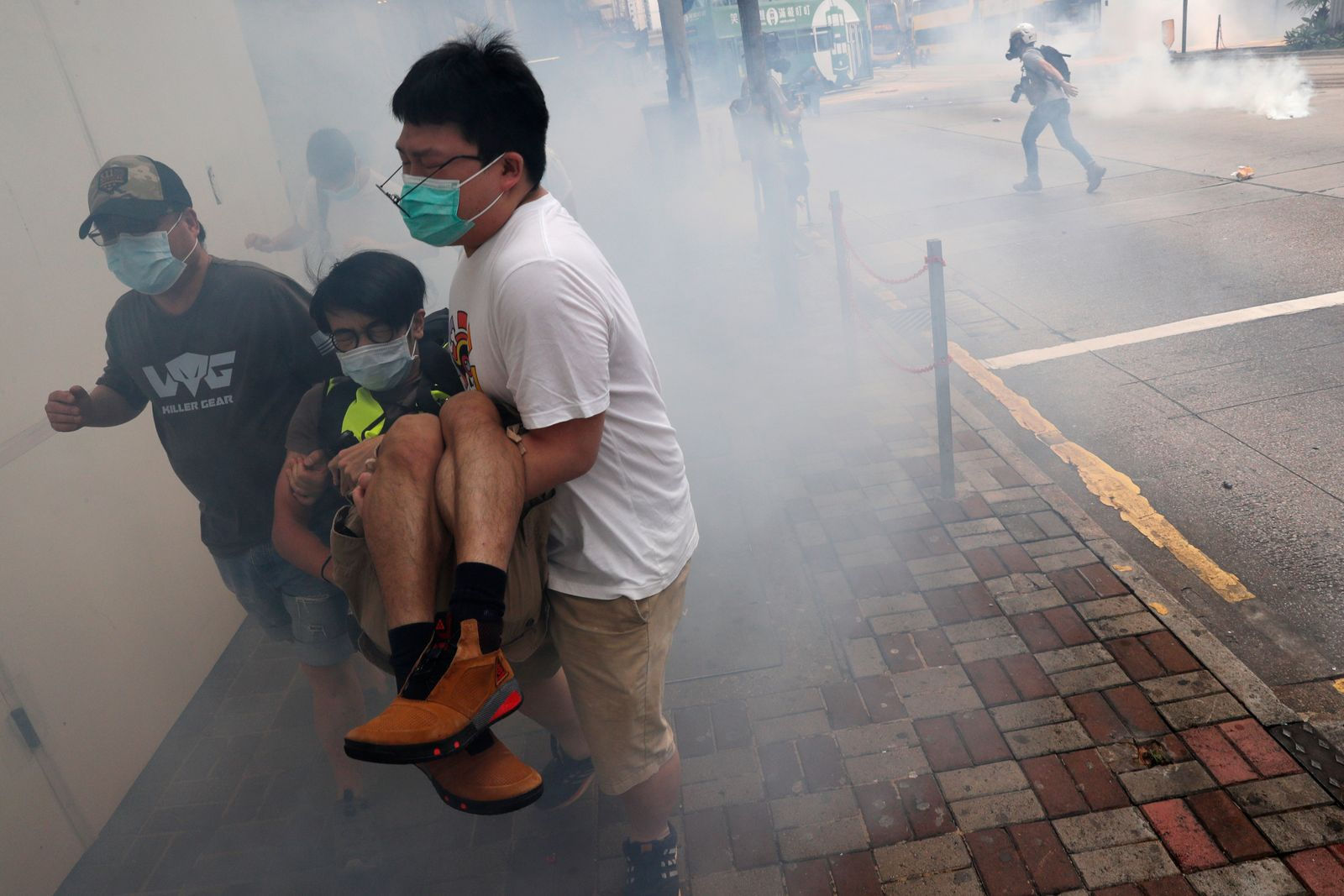 Anti-government protesters run away from tear gas during a march against Beijing?s plans to impose national security legislation in Hong Kong