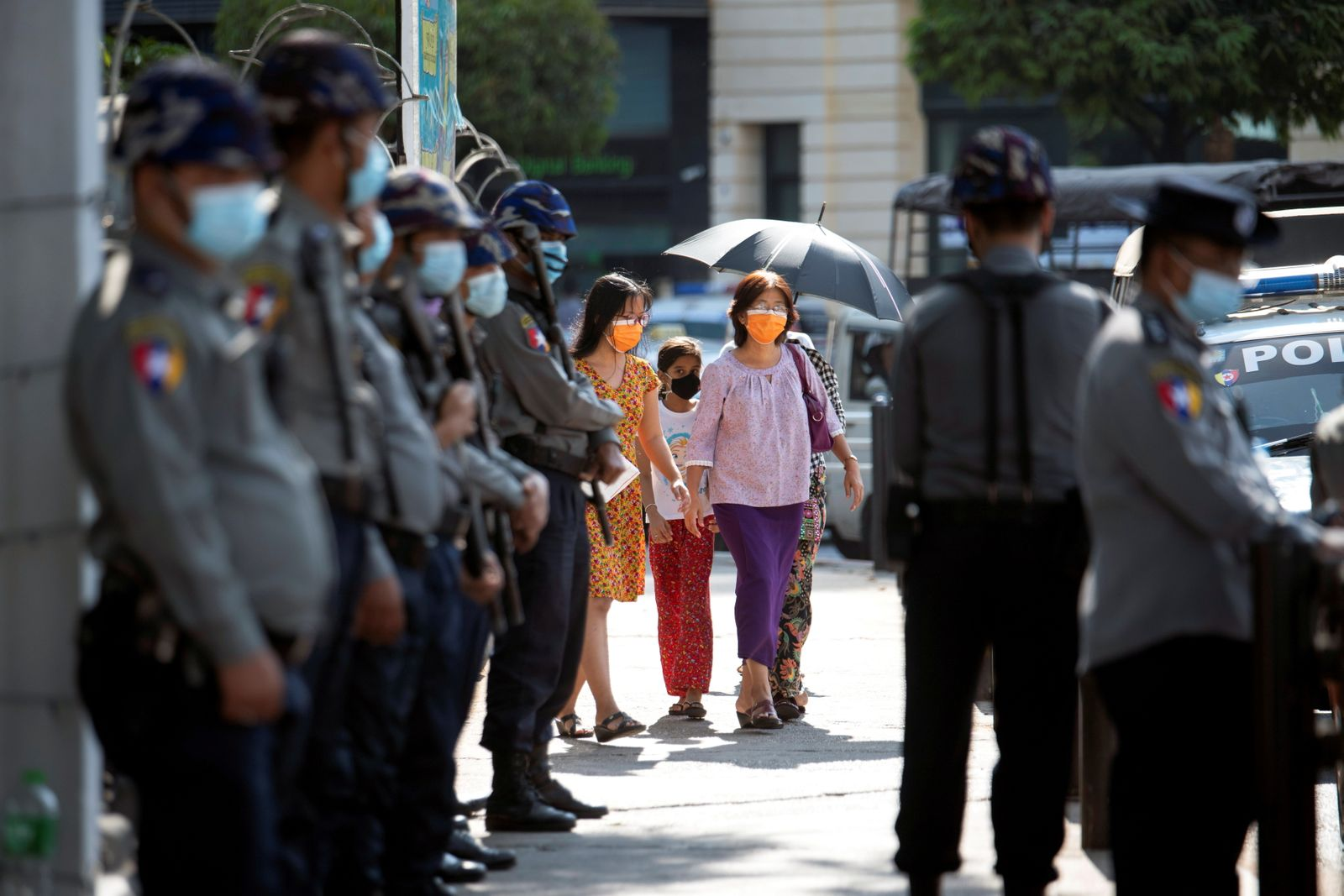 Police stan guard as they wait for protests against coup in Yangon