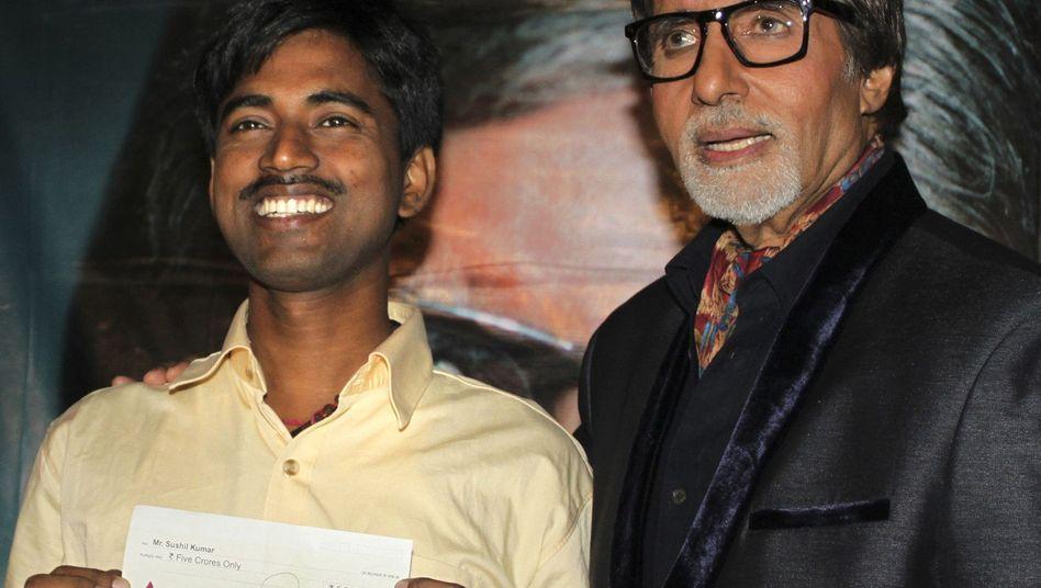 Sushil Kumar mit Moderator Amitabh Bachchan: Der Eine-Million-Dollar-Mann