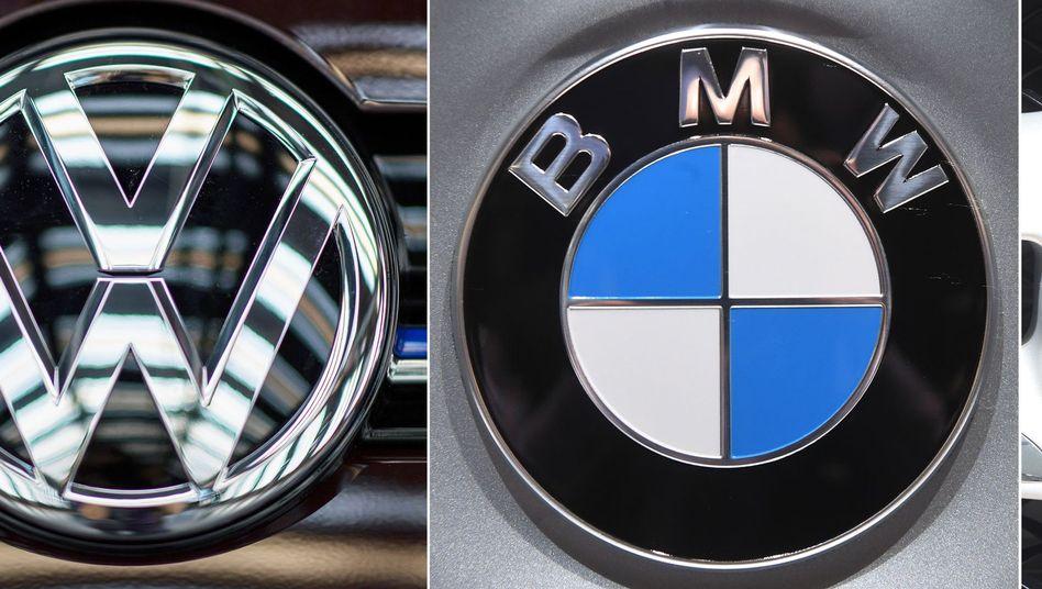 Logos von VW, BMW und Daimler: Zweimal im Jahr mit Stahlherstellern getroffen