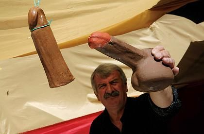 A resident of the town of Tyrnavos in central Greece participates weilds a model phallus at the town's famous pagan phallus carnival.