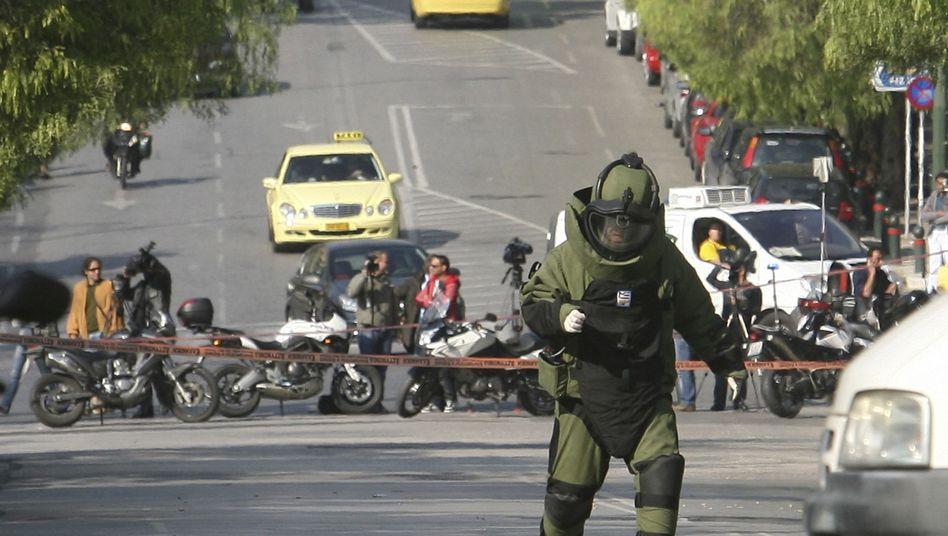 An explosives expert in Athens on Monday arriving on the scene to defuse a package bomb.