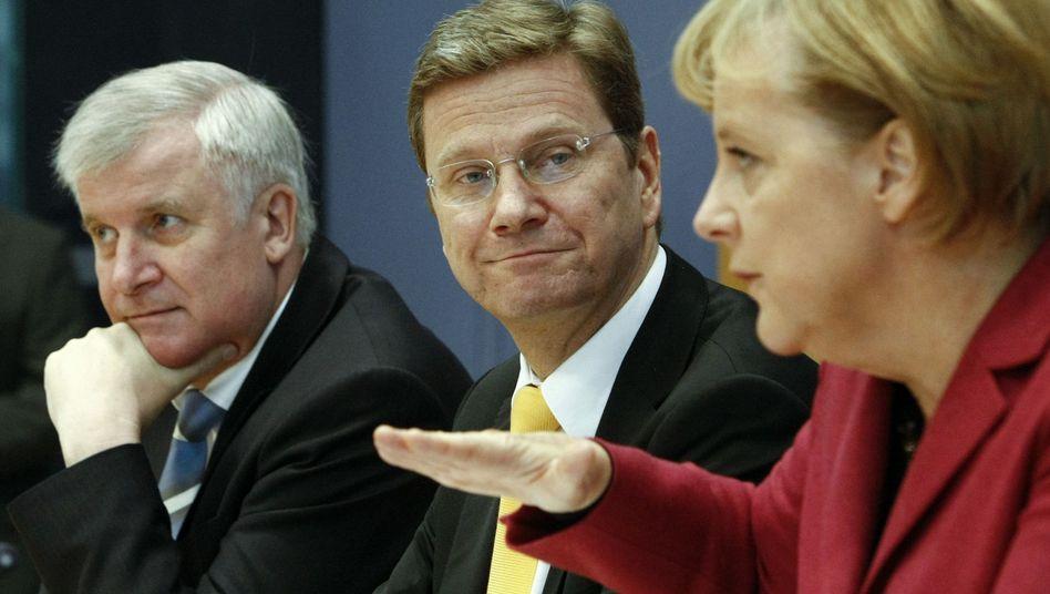 Horst Seehofer, Guido Westerwelle und Angela Merkel: Mehr netto durch Gesundheitsreform
