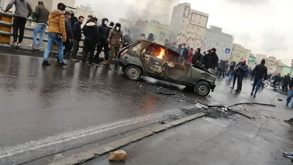 Protesters in Iran at a demonstration against the announced fuel price increase in Iran