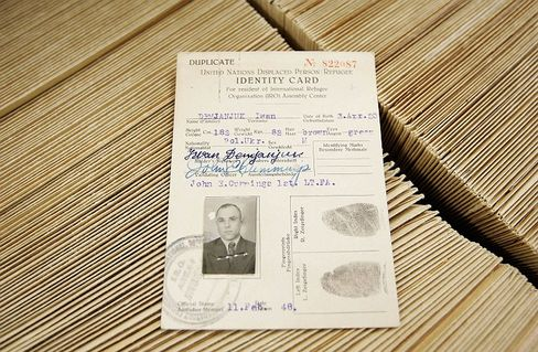 A copy of John Demjanjuk's UN identity card from when he was a displaced person: The trial of the suspected camp guard will be a legal first in Germany.
