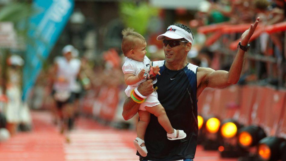 Läufer mit seinem Kind
