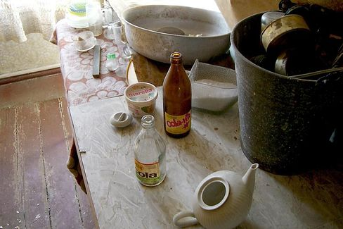 Empty bottles and dishes on the kitchen table: A long-abandoned apartment has given a glimpse into life in communist East Germany.
