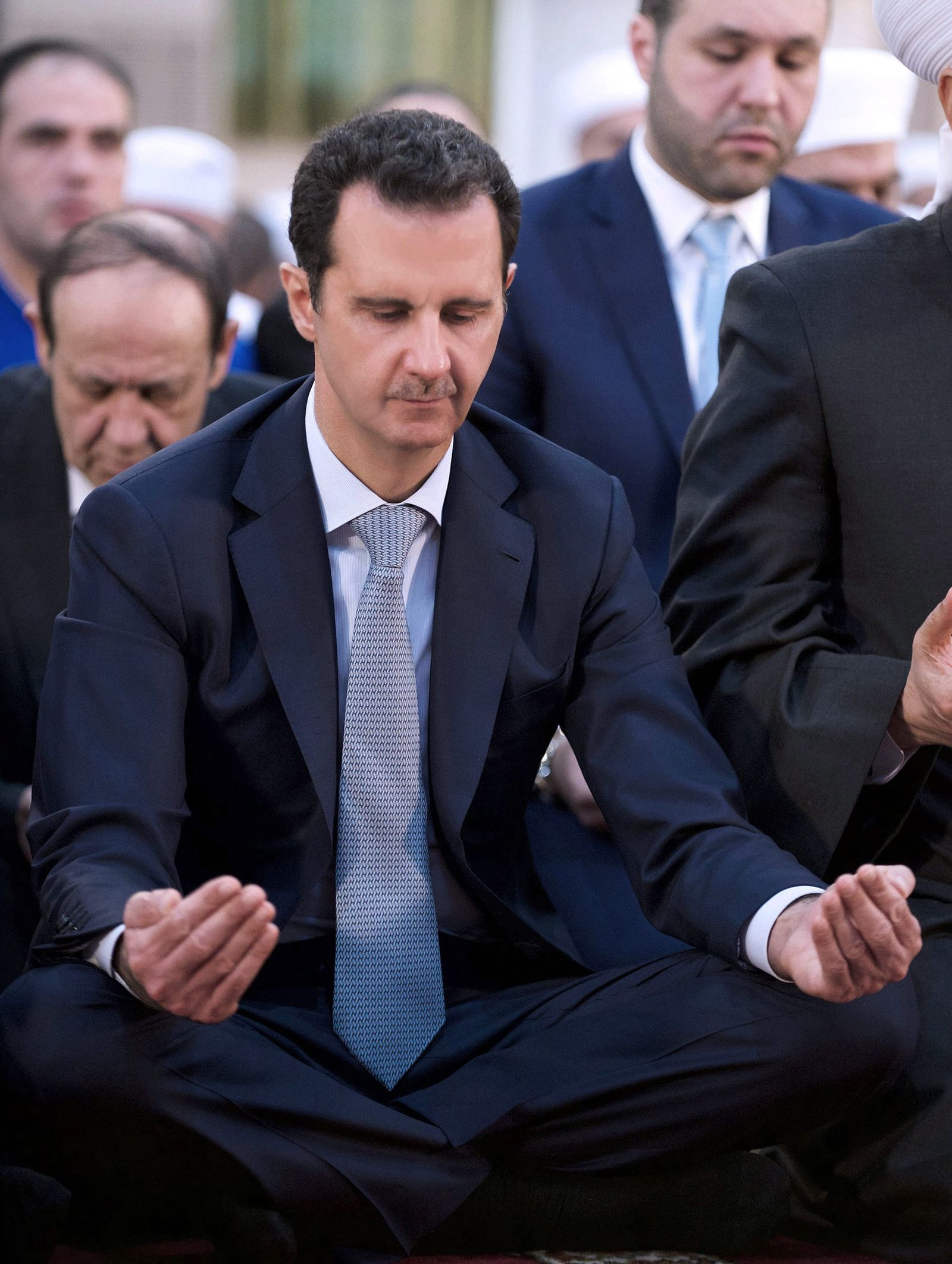 Syrian President Assad attends morning prayers during Eid al-Adha