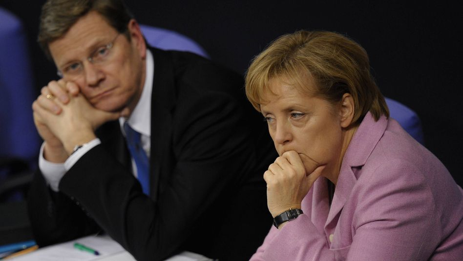 Not such a happy partnership: FDP leader Guido Westerwelle and Chancellor Angela Merkel.