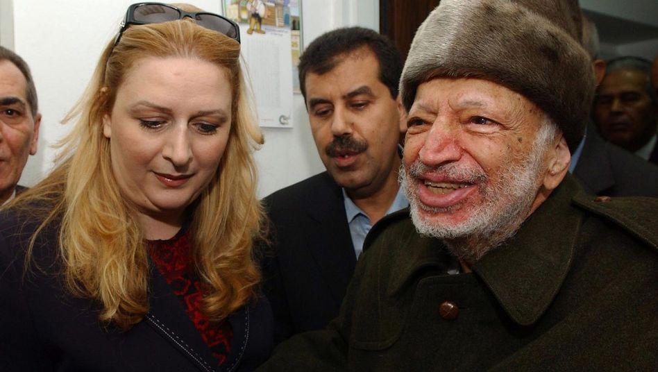 """Jassir Arafat und seine Frau Suha (Archiv):""""ein Verbrechen aufklären"""""""
