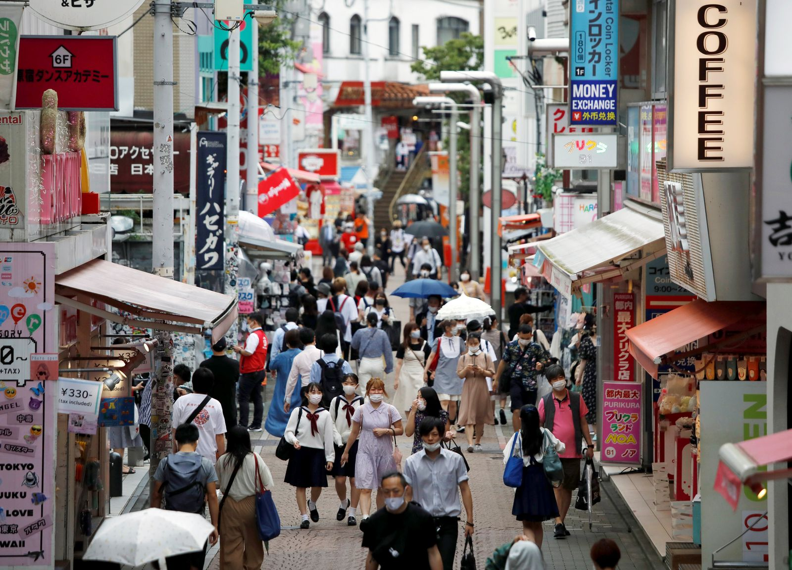 Passersby wearing protective face masks are seen at Takeshita Street, a popular sightseeing spot amid the coronavirus disease (COVID-19) outbreak in Tokyo