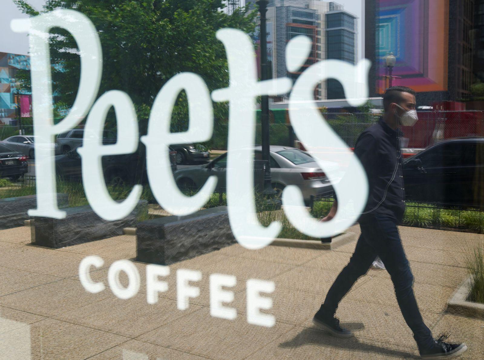 A man passes a Peet's coffee shop in Washington