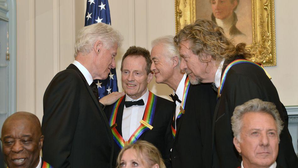 2012 in Washington: Ex-Präsident Bill Clinton und Mitglieder der Rockband Led Zeppelin