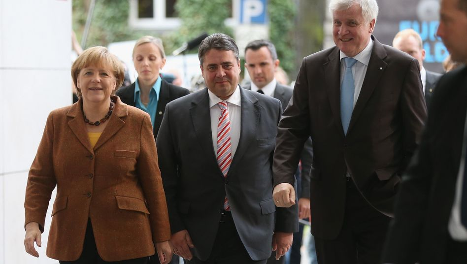 The heads of parties in Germany's future coalition government: Angela Merkel, Sigmar Gabriel (center) and Horst Seehofer (right)