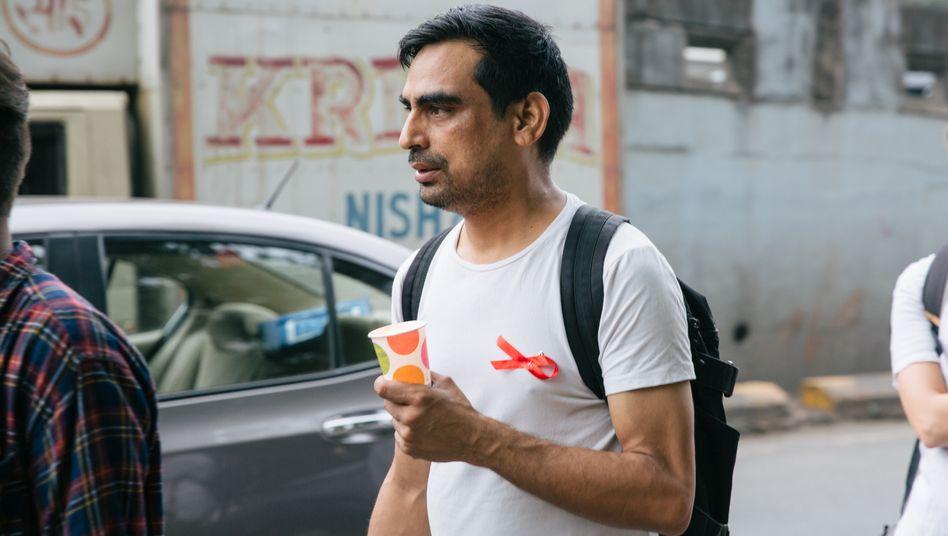 Ganesh Acharya beim jährlichen Aids Candle Walk in Mumbai zum Gedenken an die Verstorbenen