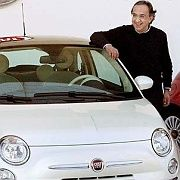 Fiat CEO Sergio Marchionne stands in front of the company's popular Cinquecento automobile.
