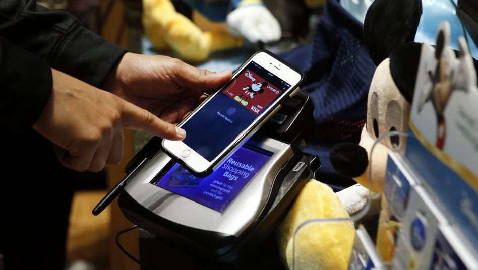 Apple-Pay-Transaktion (im Disney Store am Times Square): Widerstand vom Einzelhandel
