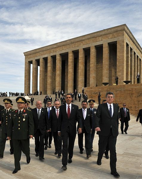 Obama leaves a wreath-laying ceremony as he is flanked by officials at the mausoleum of Mustafa Kemal Atatürk, founder of modern Turkey, in Ankara.