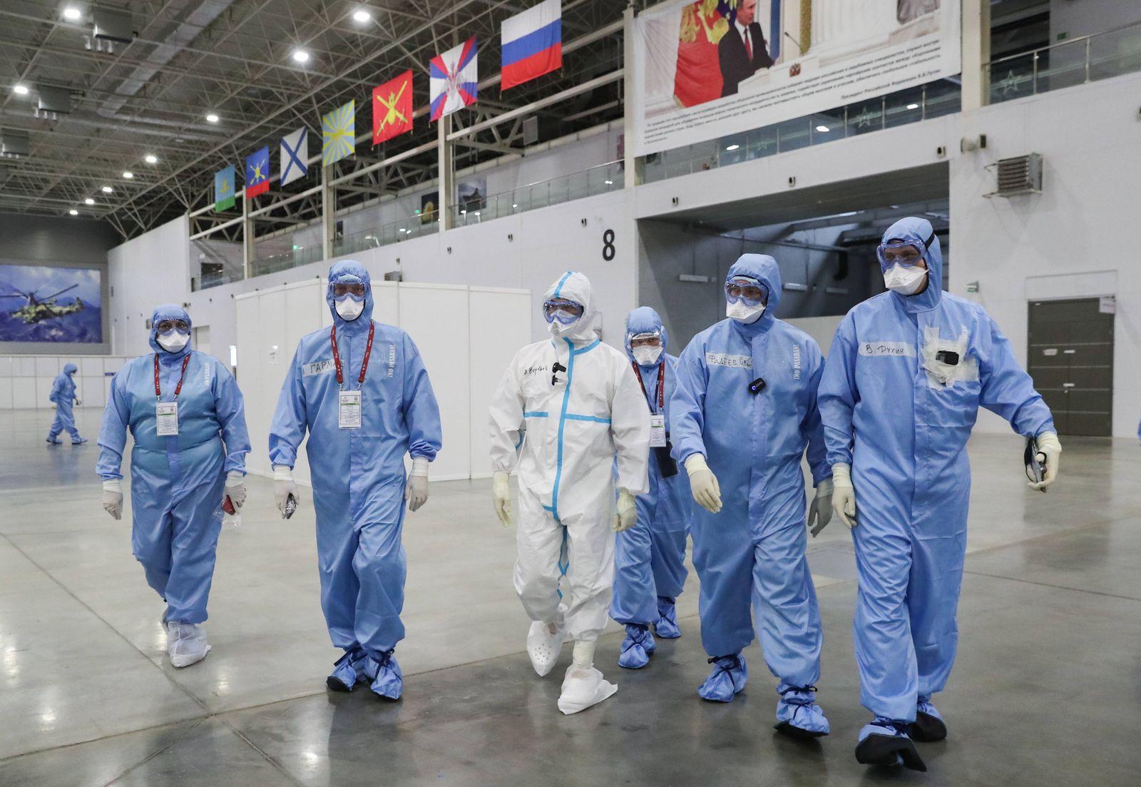 MOSCOW REGION, RUSSIA - NOVEMBER 10, 2020: Moscow Region Governor Andrei Vorobyev (C) visits a temporary medical facili